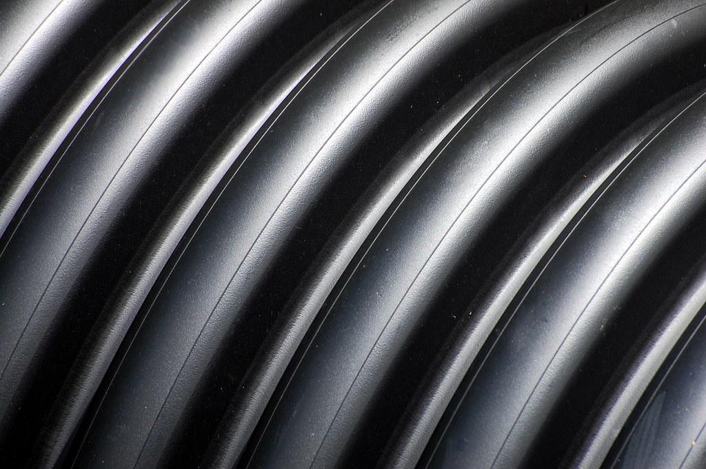 Spiral black plastic pipe texture