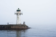 Lighthouse in summer fog by TAKleven