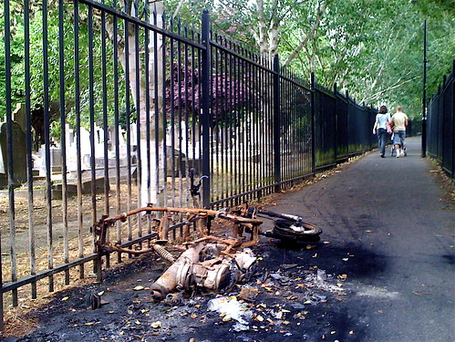 Burned Motorcycle In A Cemetery | by Neal Romanek