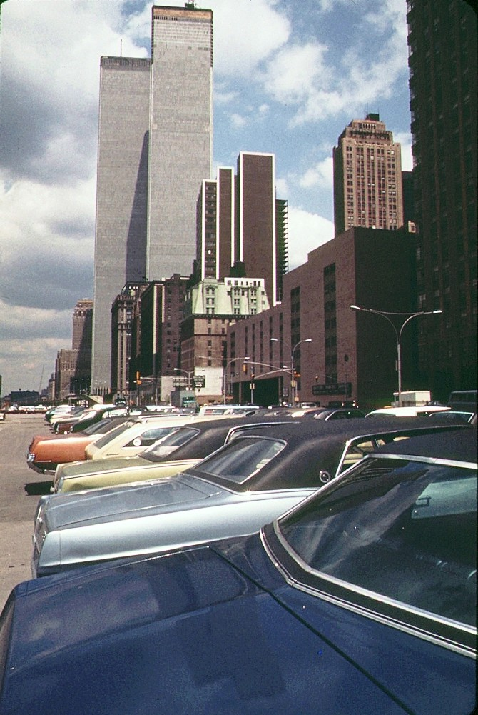 world trade center with lots of colorful 1970s cars by wes. Black Bedroom Furniture Sets. Home Design Ideas