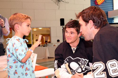 Chris Kunitz and Eric Godard with a patient | by ChildrensPgh