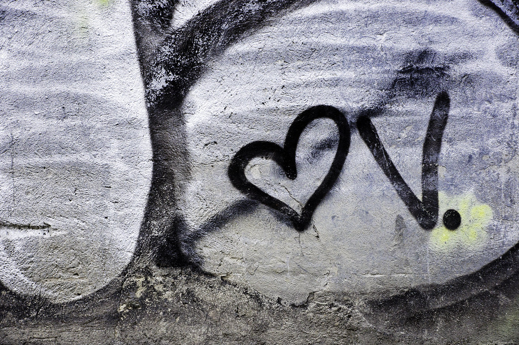 Graffiti of letter v next to a cupid's heart | Black ...