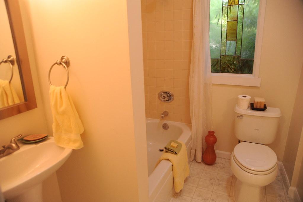 Bathroom Mirror Basin Towel Ring Tub Toilet Lighting Staged House