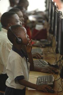 People work on computers at the Busy Internet computer center in Accra | by World Bank Photo Collection