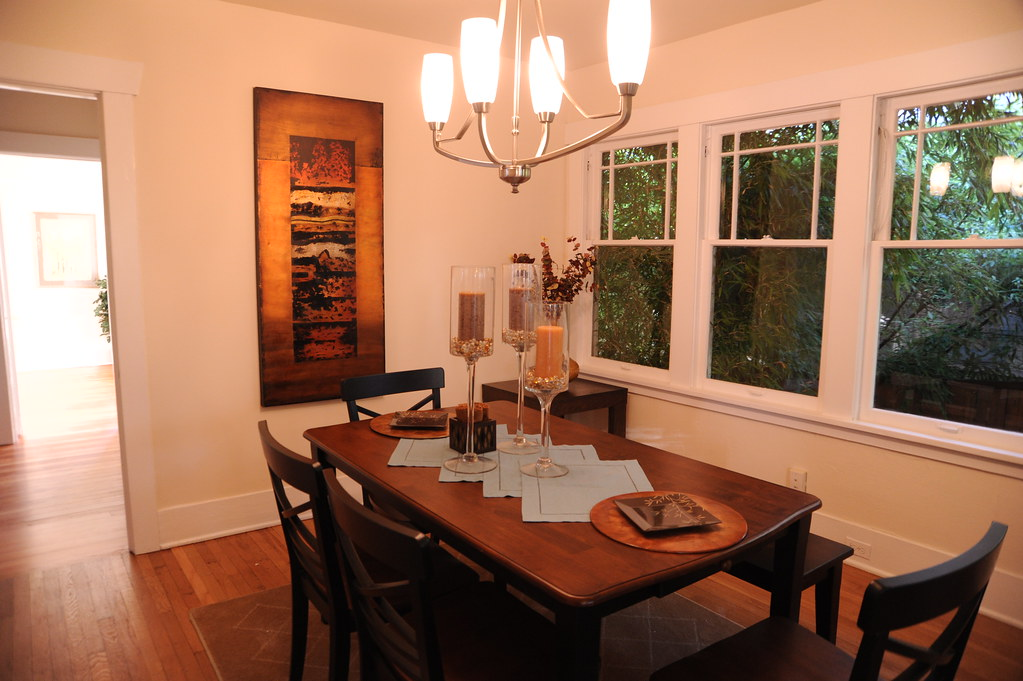 Light pours in from a back bedroom into the dining room for Dining room c house of commons