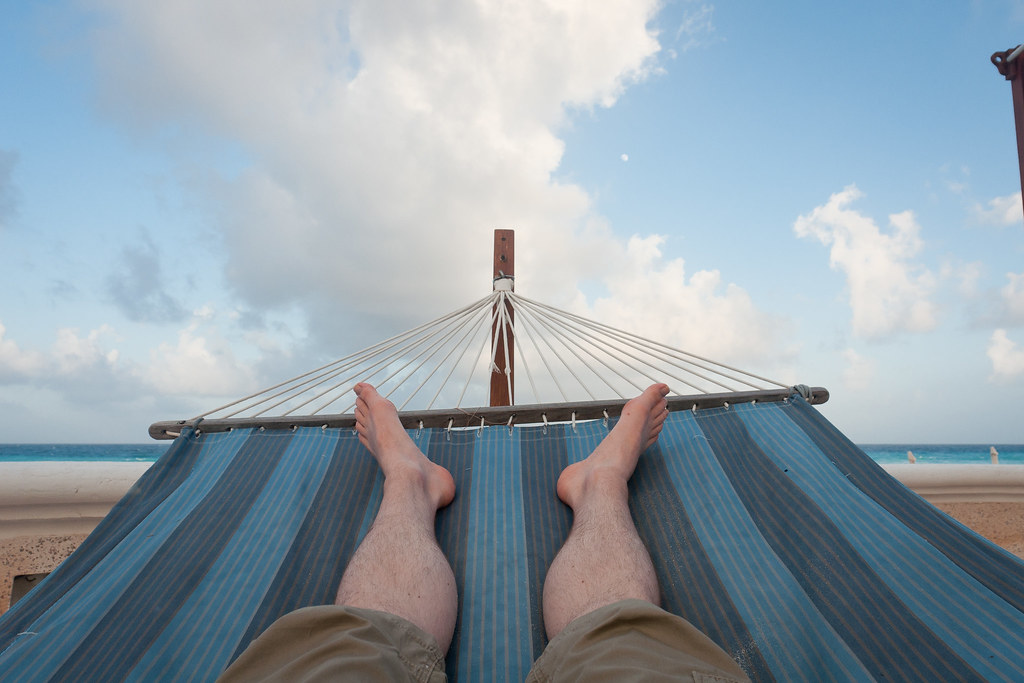 lying in a hammock Perhaps you've sequestered your hammock in your backyard, and only lie down on it occasionally to read a book or drink a glass of wine it may be a good idea to set one up in your bedroom, or even let a hammock replace your actual bed, though.