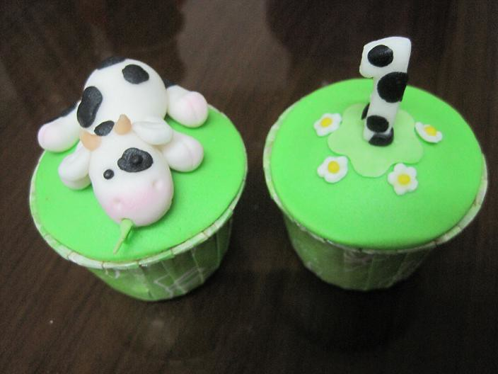 1st birthday cupcakes closer look of the cow and no 1 with flickr