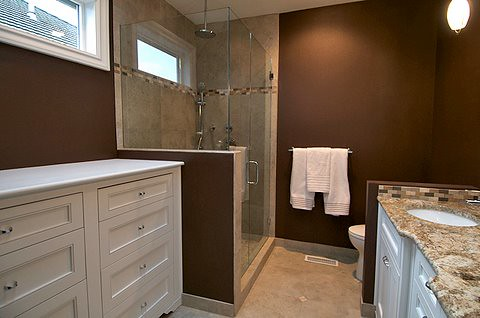 Glass-walled shower, plenty of storage | by Sitka Projects LLC