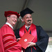 President Rush with graduate