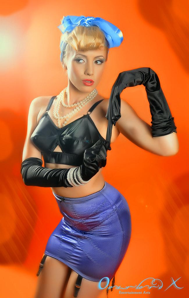 black gloves  black bullet bra and purple girdle