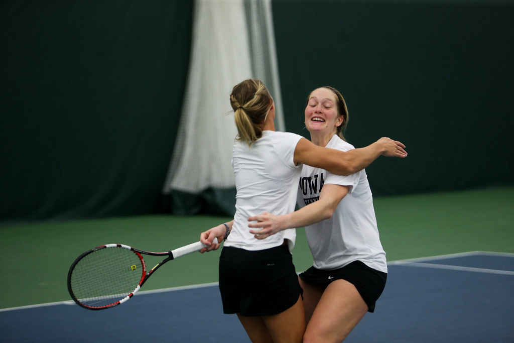 Iowa's Aimee Tarun celebrates with Natalie Looney after winning her singles match.