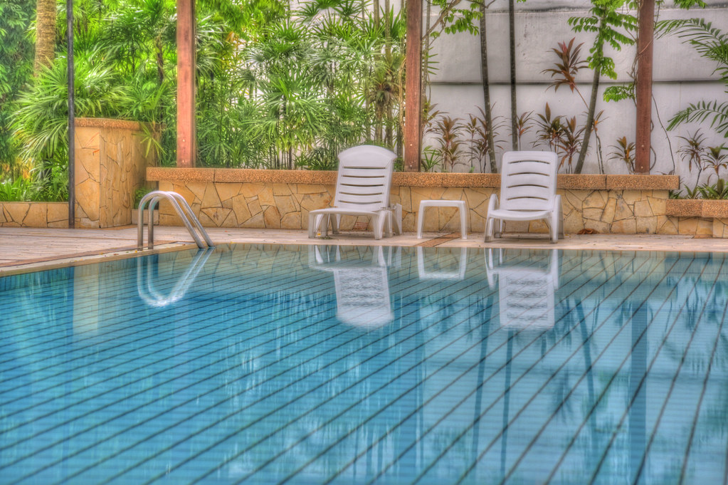 White Pool Deck Chairs: The Swimming Pool At Our Condo