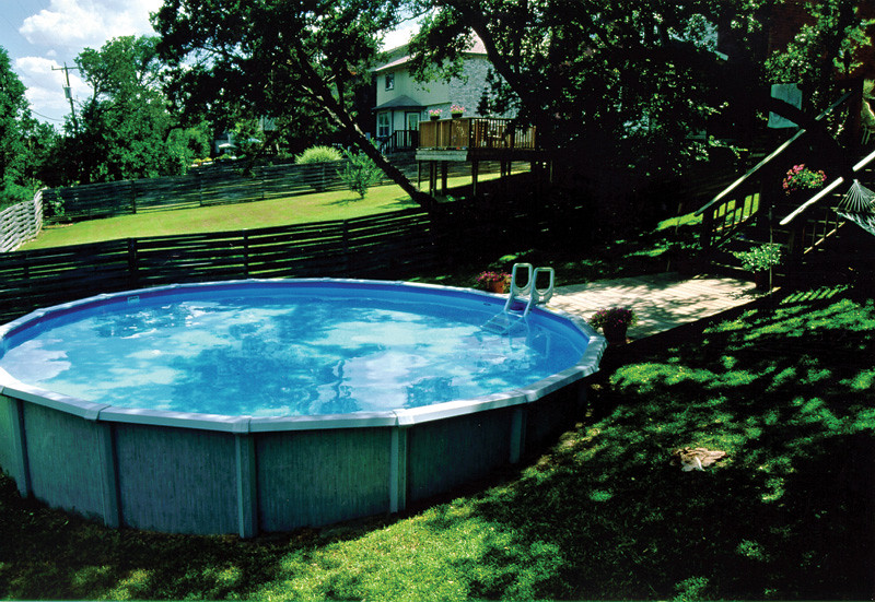 Above ground pool in sloped backyard swimming pool ideas for Pool design sloped yard