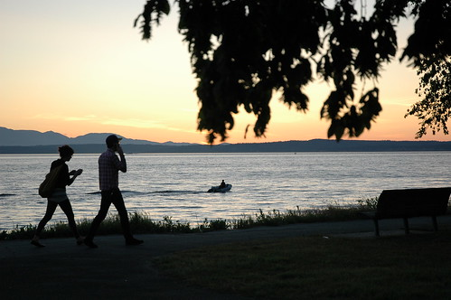 Cell phones in nature, a couple walking making calls, Golden Gardens Park, nightfall, boat, Seattle, Washington, USA | by Wonderlane