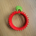 Tomato made of a bracelet and a ring