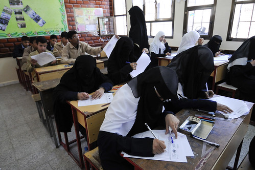 Male and female students sit for an examination at the Shaheed Mohamed Motaher Zaid School | by World Bank Photo Collection