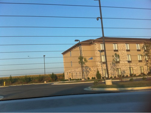Next to scary-assed motel next to cornfield on a pit stop. I am NOT getting out of the car! | by punkwalrus