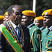 President Robert Mugabe inspects the guard of honour during the opening ceremony of the Parliament in Harare, Tuesday, July, 13, 2010. The Southern African state has established a coalition government and is drafting a new constitution.
