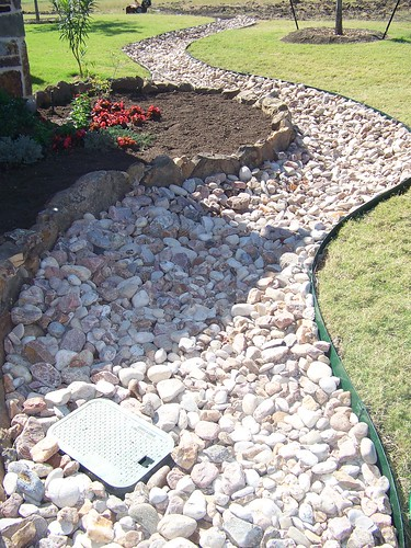 River rock install and landscape graves lawn and for Laying river rock