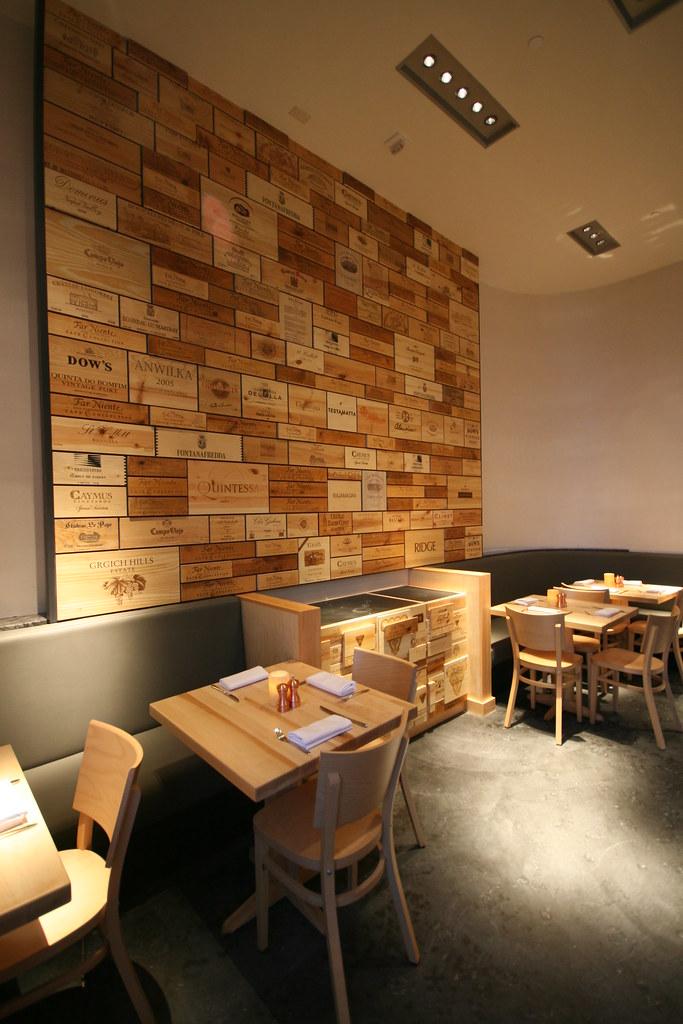 Sonoma Wine Garden: the wall of wine crates in the main di ...