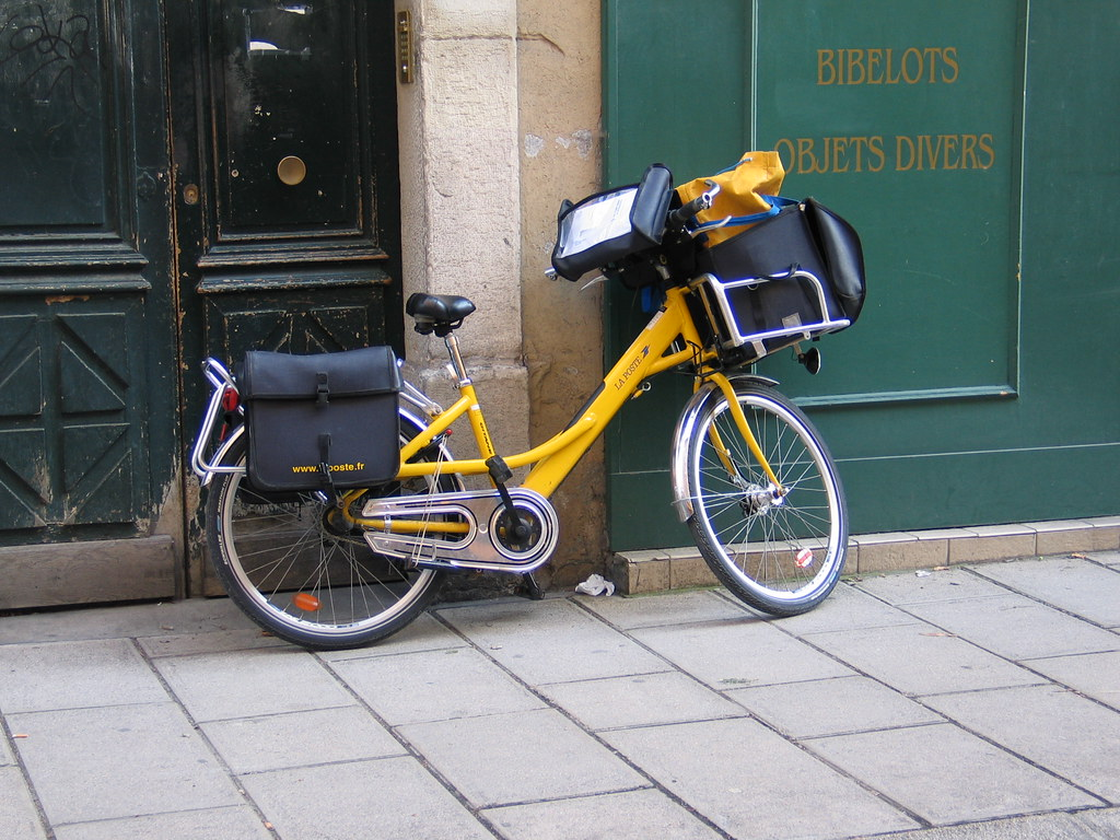 Bicycle For Delivery Near Cars