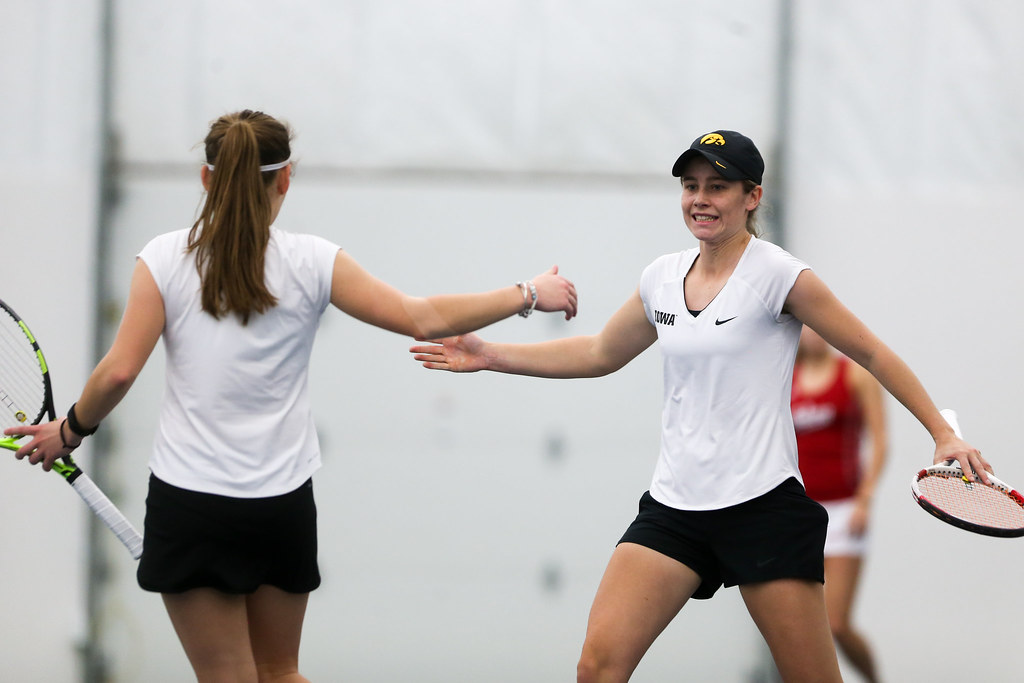 Elise van Heuvelen celebrates with Zoey Douglas after winning a doubles game.