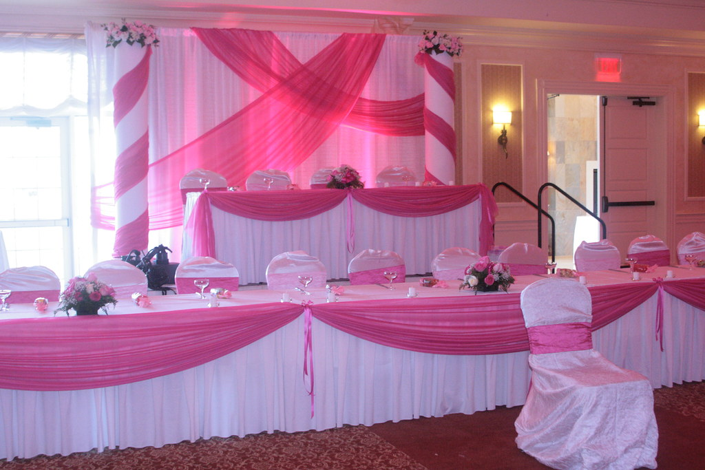 Head table fabric draping and backdrop for pink theme quin for Quinceanera decorations