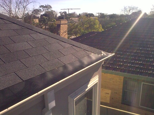 Three tab fibreglass based asphalt shingles with gutterguard | by Asphalt Shingle Roofing Company
