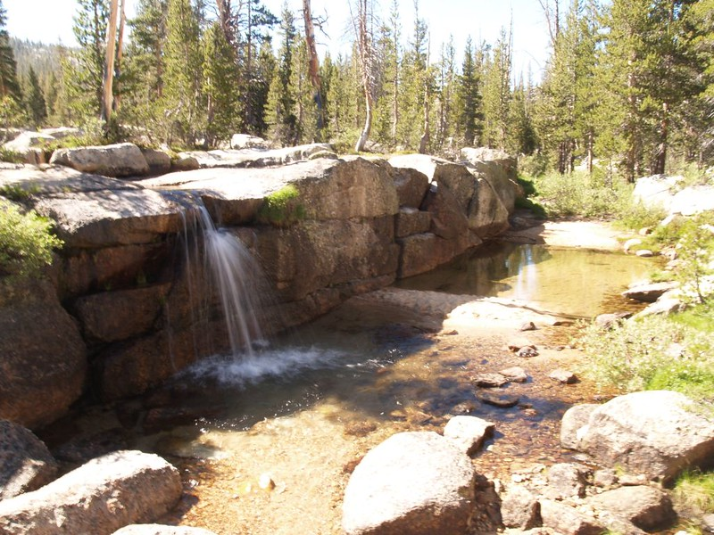 A waterfall and a granite wall on Rafferty Creek