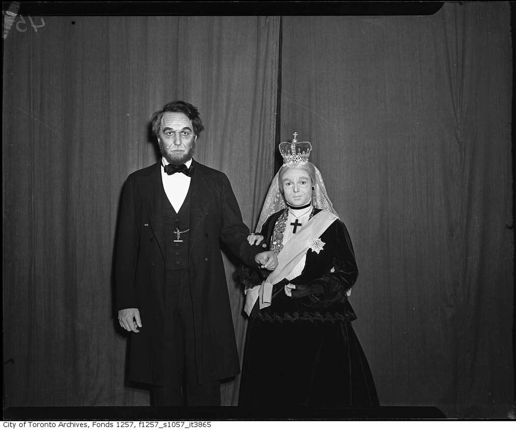 Anna Neagle In Costume As Queen Victoria With Man In Cost