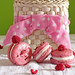 raspberry macarons in front of basket