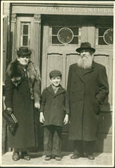 Rabbi Jacob Meir Sagalowitch, wife Bluma Borishansky Sagalowitch, grandson Joel Sagall by synagogue | by Center for Jewish History, NYC