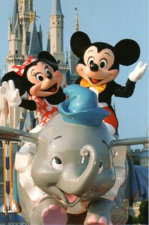 Mickey and Minnie on Dumbo ride front | by coconut wireless