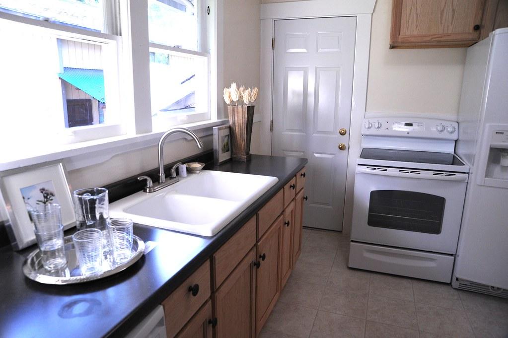 Glasses, kitchen sink, electic range, kitchen, staged hous? Flickr