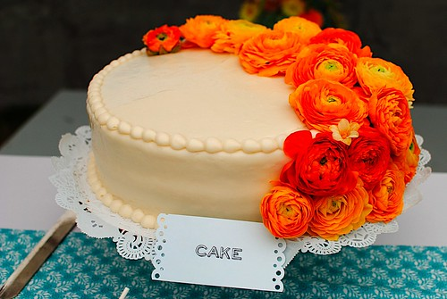 Cake Decorated With Gumdrop Flowers : Cake decorated with orange ranunculus flowers Photo ...