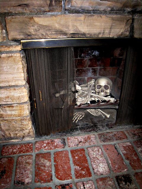 Halloween decorating ideas skeleton bones in fireplace Scary halloween decorating ideas inside