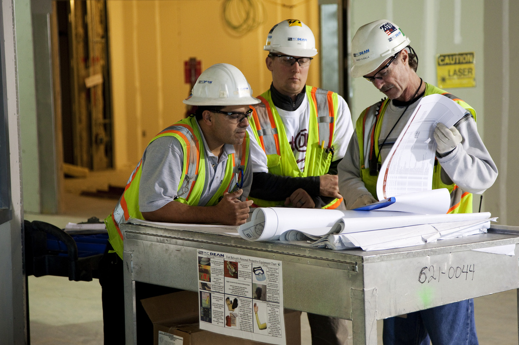 Contractors reviewing blue prints.