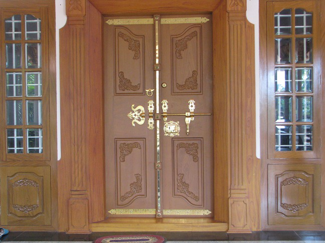 Doors modern traditional doors in kerala arunpnair for Traditional main door design