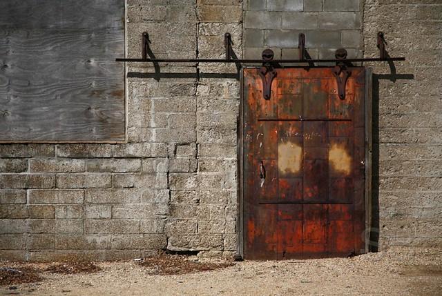 Rusty warehouse door as old as the door looks it for Door to gate kontakt
