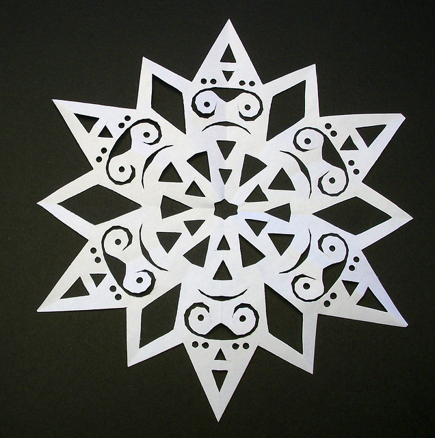 how to make fancy snowflakes out of paper