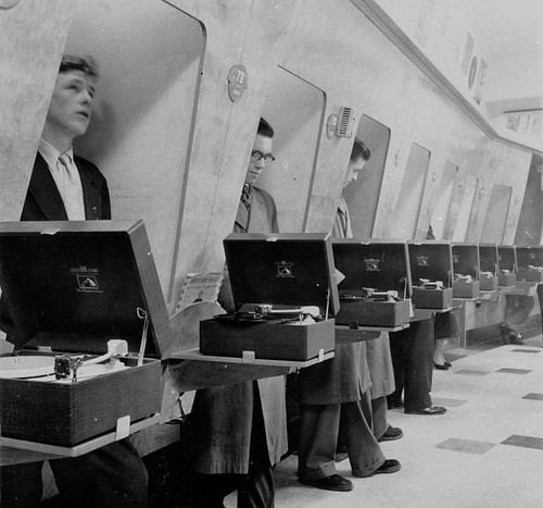 hmv 363 Oxford Street, London - Customers using listening booths 1950s | by hmv_getcloser