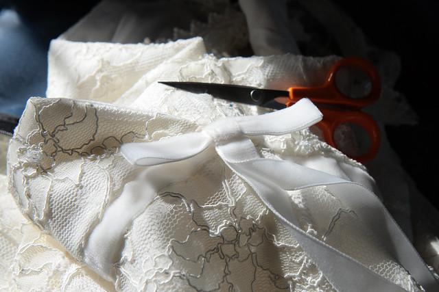 Putting the finishing touches onto Zoe's wedding dress