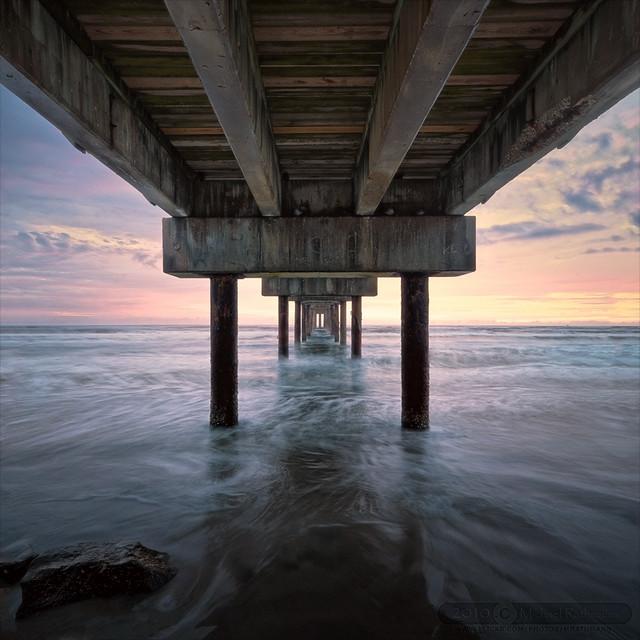 Catching sunrise under a st augustine pier flickr for St augustine fishing pier