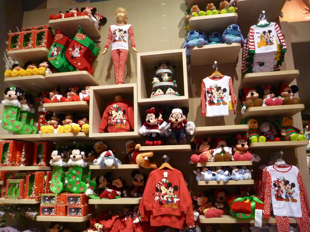wall of disney christmas merchandise at disney store times