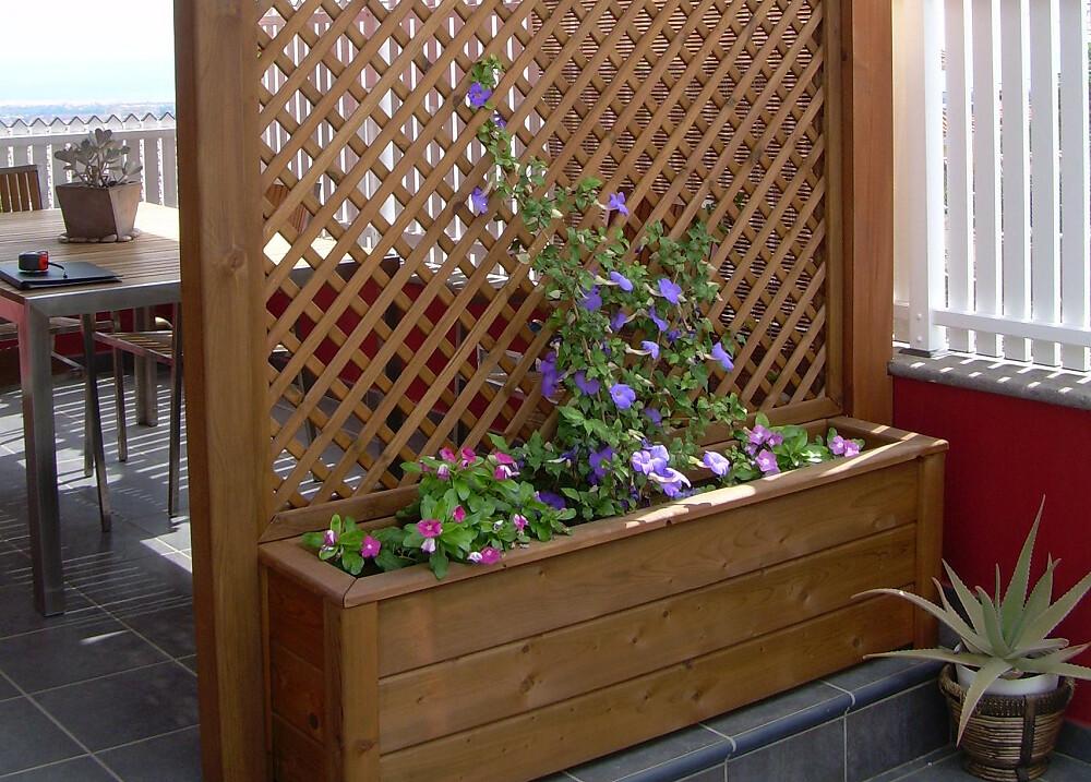 Jardineras de madera exterior for Jardineras con palets de madera