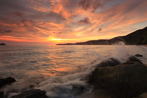 Crashing waves over sunset | by ChR!s H@rR!0t