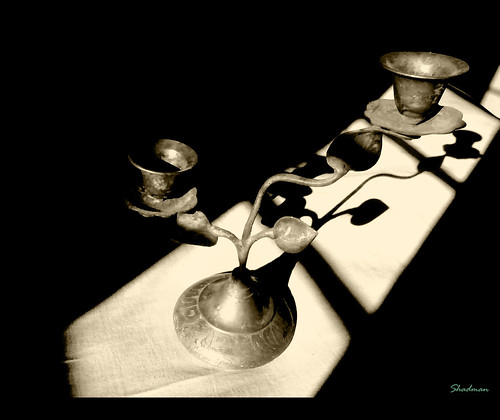 an old candle stand | by shadman ali