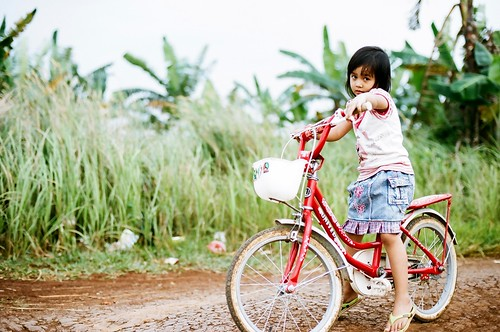 little girl with red bike | by khaniv13
