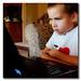 karate kid   TK watching movie on laptop