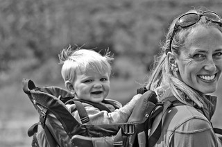 a photo of a mother hiking with her baby in a backpack